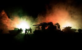 War Concept. Military silhouettes fighting scene on war fog sky background. World War Soldiers Silhouette Below Cloudy Skyline At night stock photography