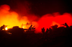 War Concept. Military silhouettes fighting scene on war fog sky background, World War Soldiers Silhouettes Below Cloudy Skyline At Stock Photos