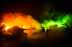War Concept. Military silhouettes fighting scene on war fog sky background, World War Soldiers Silhouettes Below Cloudy Skyline At Royalty Free Stock Photo