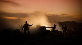 War Concept. Military silhouettes fighting scene on war fog sky background, World War Soldiers Silhouettes Below Cloudy Skyline At Stock Photography