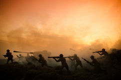 War Concept. Military silhouettes fighting scene on war fog sky background, World War Soldiers Silhouettes Below Cloudy Skyline At Royalty Free Stock Images
