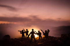 War Concept. Military silhouettes fighting scene on war fog sky background, World War Soldiers Silhouettes Below Cloudy Skyline At. Night. Attack scene. Armored Stock Photo