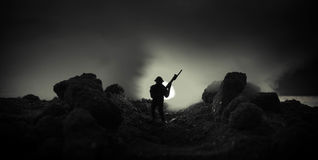 War Concept. Military silhouettes fighting scene on war fog sky background, World War Soldiers Silhouettes Below Cloudy Skyline At. Night. Attack scene. Armored Royalty Free Stock Image