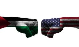 The War between 2 Countries. The unfair War between Palestine and USA countries / closed fist royalty free stock photo