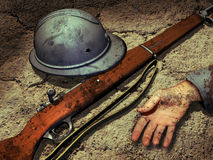 War death. On the ground, the hand of a dead soldier, his gun and his helmet with a bullet impact Royalty Free Stock Photography