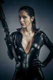 War Defence, Sexy girl military woman posing with guns. Royalty Free Stock Photos