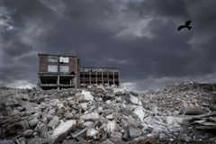 War and demolition with debris and building and raptor. In the dark sky Royalty Free Stock Images