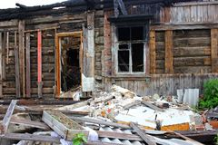 War destroyed, burned down wooden house, charred walls, Stock Photography