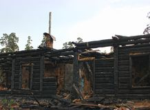 War destroyed, burned down wooden house, charred walls Royalty Free Stock Photo