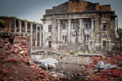 War devastation fear, scenery, wet, dirty, home town. Abandoned houses and ruined city wet and muddy Royalty Free Stock Images
