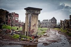 War devastation fear, scenery, wet, dirty, home town. Abandoned houses and ruined city wet and muddy,Stalingrad Stock Photos