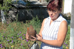 The war in eastern Ukraine. KRASNY LIMAN, UKRAINE - SEPTEMBER 06: A woman holds the remains of an artillery shell that destroyed her home in the village Krasny stock photos