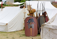War Equipment in an Ancient Roman Encampment. Shields, spears and other war equipment in an ancient roman encampment Stock Images