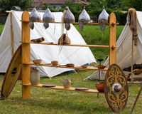 War Equipment and Other Utensils in an Ancient Celtic Encampment. Helmets, shields, vases and amphoras in an ancient celtic encampment Stock Photos