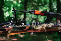 War guns arsenal. Modern military assault rifles shotgun weapon arms outdoors on natural background stock photography