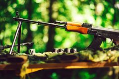War guns arsenal. Modern military assault rifles shotgun weapon arms outdoors on natural background stock photos