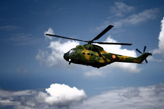 War helicopter. A flying helicopter, getting to the base Royalty Free Stock Photo