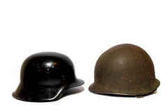 War Helmets. Isolated world war two army helmets from the Axis and Allied powers Royalty Free Stock Photo