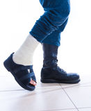 War and injury - cast and combat boot concept Stock Image