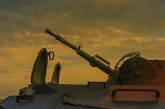 War machine gun on tank. Heavy war machine gun on tank on a dramatic sky background Royalty Free Stock Image