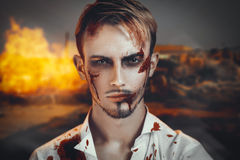 War man portrait. Portrait of a man who suffered during the war, was the victim of terrorist attack. Beautiful face disfigured with scars, wounds, bloody streaks Stock Image