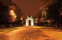 War Memorial approach at night with autumn leaves. War Memorial approach at night time with autumn leaves, Victoria Park off University Road, Leicester, England stock photo