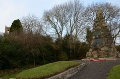 War Memorial Cairn in Bankfoot, Perthshire. A view of a stone war memorial cairn in the rural Perthshire village of Bankfoot Royalty Free Stock Photos