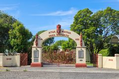 War memorial gate in New Zealand, with Maori artwork. The war memorial at Te Matai School, Te Puke, New Zealand. Commemorating the soldiers of both World Wars stock photography