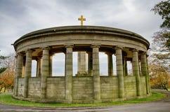 War memorial in Greenhead Park, Huddersfield, Yorkshire, England. With dark, ominous skies royalty free stock images
