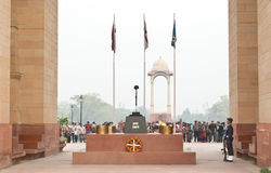 The war memorial at India Gate in New Delhi. With eternal fire, a rifle carrying helmet and an Airforce guard , to honour the supreme sacrifice of the dead Stock Photo