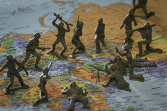War in the Middle East. Concept image using a wold map and toy soldiers to represent a war on the Middle East stock photo
