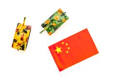 War, military threat, military power concept. China. Tanks toy near chinese flag on white background top view.  stock photo