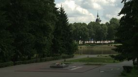 War monument and lake in summer city park view. War monument and beautiful lake in city park on a sunny warm summer day view stock video footage