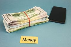 Free War Of Money And Phone Lying On A Blue Background Royalty Free Stock Image - 159825926