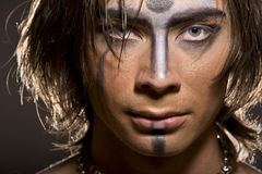 A war paint warrior is American Indian. A war paint of warrior is American Indian Royalty Free Stock Image