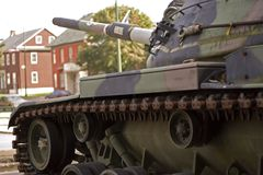 War and peace. Old tank on the peacefull street Stock Photography