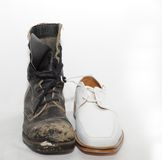 War and Peace. Old Well Worn  Military Boot and White Shoe Stock Image