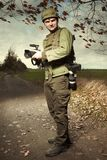 War photographer in conflict zone preparing for job Royalty Free Stock Images