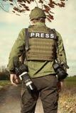 War photographer in conflict zone preparing for job Stock Photo