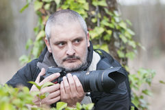 War photojournalist in a wild jungle. Royalty Free Stock Image