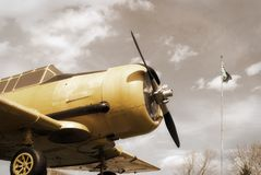 War Plane Monument. A vintage edit of an old historic war plane on display in a public park, located in Smiths Falls, Canada Royalty Free Stock Images