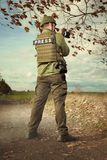 War press photographer taking pictures. Photographer in war conflict field zone observing royalty free stock photo