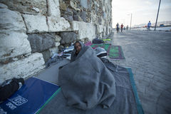 War refugee sleeping on the street. More than half are migrants from Syria, but there are refugees from other countries Royalty Free Stock Images