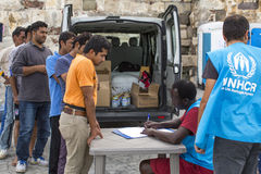 War refugees are registered employees of the UNHCR - The UN Refugee Agency. KOS, GREECE - SEP 27, 2015: War refugees are registered employees of the UNHCR - The Stock Photography