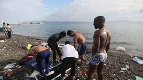 War refugees wash up on the beach. Many refugees come from Turkey in an inflatable boats. stock footage