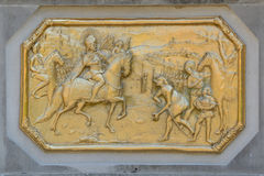 """War"" relief. Bronze copy of the original copper War relief placed on the immaculate Plague Column in Košice (Cassovia Stock Photo"