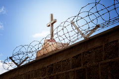 War and religion concept - Cross and barbed wire stock photos