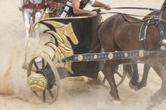 War, Roman chariot in a fight of gladiators, bloody circus Royalty Free Stock Photo