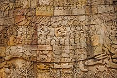 War scene carved on Bayon temple outer gallery. In the center of Angkor Thom , Siem Reap, Cambodia royalty free stock images