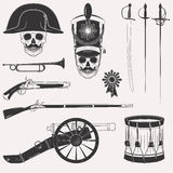 War 1812 set. Set of vintage Napoleon Empire French Russian war uniform, equipment, weapons, horn, drum, cannon, sword, rapier, medal, skull in hats isolated on Stock Photography